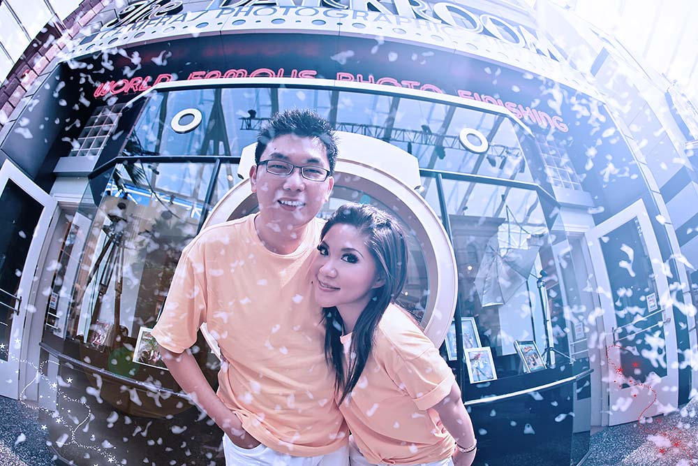 Two people in inflatable snow globe