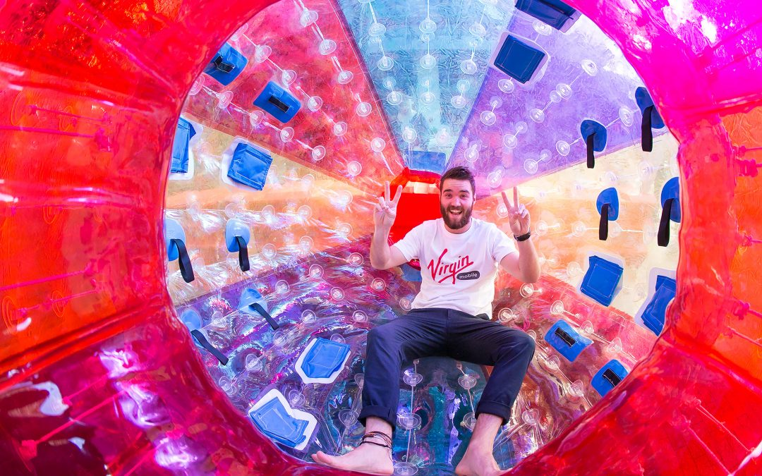 man sitting inside zorb ball
