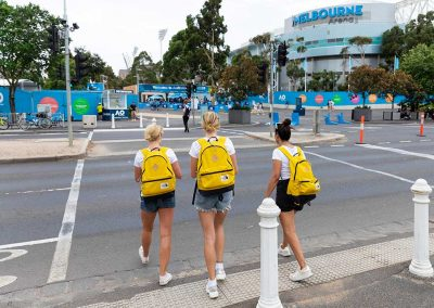 three promo staff walking across road towards Australian open - media and pr photography