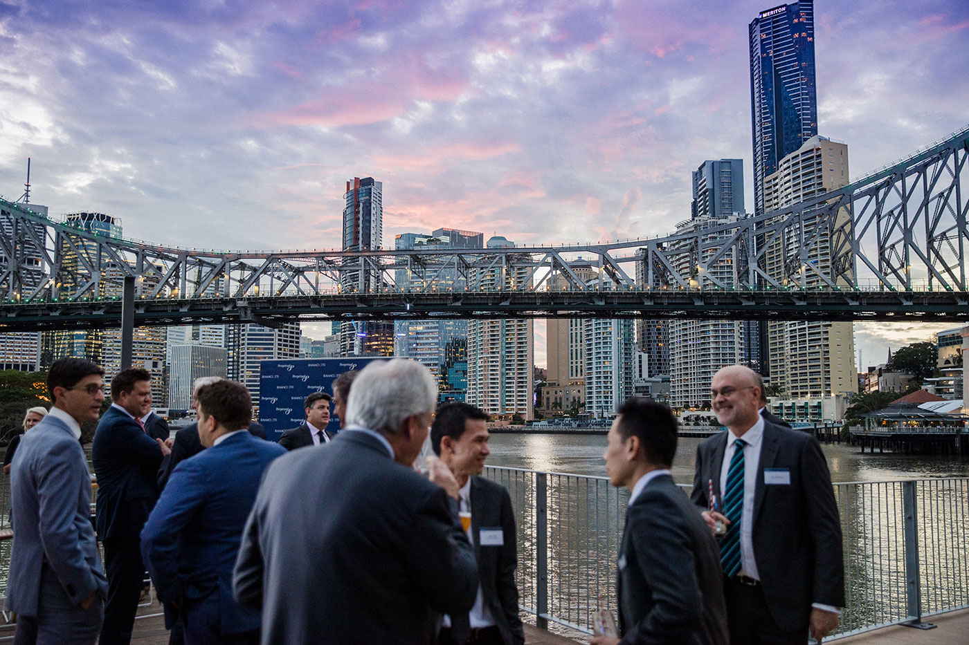 Guests overlooking Story Bridge from Howard Smith Wharves